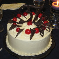 Cherries Chocalate Amaretto cake for my DH's 37th. Buttercream, glacé cherries and hand-piped chocolate decorations. It was very...