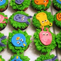 Backyardigan Cuppies For 1St Bday Fun but a pain with all the colors to knead. Fondant faces on BC covered yellow cupcakes.