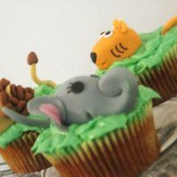 Lions And Tigers And.....elephants. Safari themed cuppies. There were zebras and monkeys also - all made of fondant. Wonderful carrot cake recipe from Vegan Cupcakes Take Over...