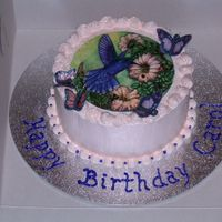 Hummingbird I used an edible image for this cake. I used butterflies printed on wafer paper that I cut out, spread with piping gel, and coated with...