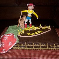 Cowgirl Cake Chocolate cake, Chocolate Bavarian filling, Chocolate Buttercream Icing, Gumpaste cowgirl, horse, bandana, rope and lettering. Figures are...