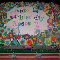 Reese's 2Nd Birthday Cake All flowers and butterflies are fondant, icing is buttercream, yellow cake with chocolate bavarian cream filling. This cake was designed to...
