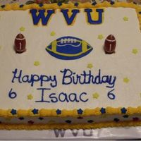 Wvu Football Cake  I did this for a friend's 6 year old son. He loves the mountainers. Chocolate w sfr icing and candy accents. Letters and ball cut from...