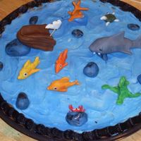 The Three Little Fish And The Big Bad Shark  My husband, son and I made this ch. chip cookie cake for the school reading fair. Buttercream icing and fondant figures. My son won 3rd...