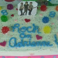 Jonas Brothers This is a quicky I did for my daughters 8th birthday. White w/ homemade white icing.