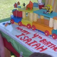 Happy Birthday Train  This is my little boys party. He loved his train cake. I had to redo the chocolate and replace it with it with fondant covered board...
