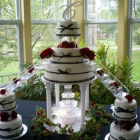 Classic Wedding Cake With A Modern Look black and red colors buttercream iced