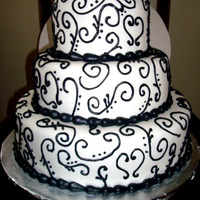 Valentines Wedding Cake! 3 tiered (6,9,12) round cake with fondant icing and black buttercream hand-piped swirls and border!