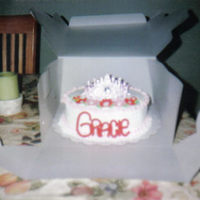 Tiara Covered in buttercream and name done in fondant. Toy tiara.