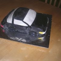 3D Shaped Car my first carved cake :) It's take from a 1992 eagle talon. I think it turned out nice for my first try.
