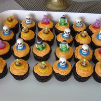 Halloween Cupcakes Cupcakes made for son's halloween block party. Toppers are ring pops.