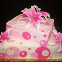 Pink Princess Iced in Buttercream with fondant circles and accented with gumpaste stargazer lilies.