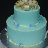 Baby Boy Shower 10-6 two tier iced in Bc with fondant bow and baby accents.