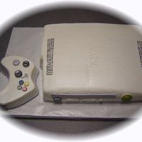 Xbox 360 buttercream, airbrushed in pearl dust, fondant accents
