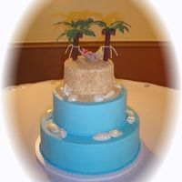 Beach Cake buttercream, cloth hammock, molded people chocolate shells.