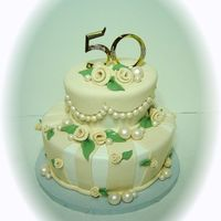 50Th whimsey, slightly carved, had to make a 3 hour trip, buttercream with fondant accents.