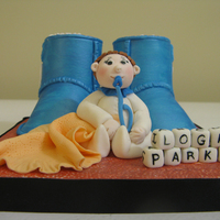 Baby Ugg Boots Topper A baby boy topper I made this week. It's for a baby shower in January for co-worker of my husband. I made baby Ugg boots from a...
