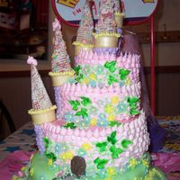 Alyssa's Princess Castle Cake Stacked tiers of almond, chocolate and raspberry marbled rum cakes torted and filled with cream cheese icing. Tops covered in marshmellow...