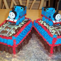 Thomas Tank Engine For Twins Two marble pound cakes of chocolate, almond, raspberry and rum baked in simple loaf pans, torted and filled and then simply iced. Decorated...