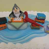 Wizard 101 This was for a 15 year old boy who was into reading and Greece and Italy (hence, the books) and fantasy. I loved doing this cake. It was...