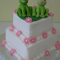 Croaky Wedding Topper Bride and groom wanted frogs as their wedding couple. They supplied toy which I molded the topper after. Frogs and lily pad are fondant....