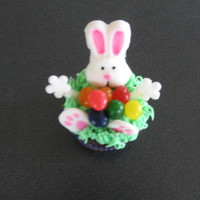 Jelly Bean Bunny Cupcakes Fondant bunny head and feet. Icing is buttercream. Middle of cupcake filled with jelly beans.
