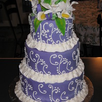 Purple Cake With Gum Paste Flowers Entered in the NC State Fair, did not place. Purple fondant with royal icing scroll work. Gumpaste flowers.