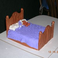 Slumber Party Bed  Slumber Party Bed Cake. Painted fondant foot and headboard. Fondant blanket and teh pillows are marshmellows wraped in fondant. The bear...