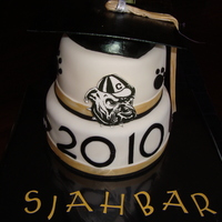 Black And Gold Graduation Cake Buttercream with fondant with fondant decorations. Hand painted bulldog plaque on gumpaste - motarboard also gumpaste