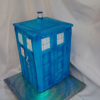 Dr. Who Tardis Cake Gumpaste panels for the sides and top of tardis. This was a bit more time consuming, but really fun to make for a Dr. Who fan.