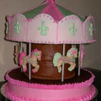 "Carousel This cake had 12"" cake base and top with a tower of 6"" cakes in the middle; white chocolate horses w/ RI; fondant accents. The..."