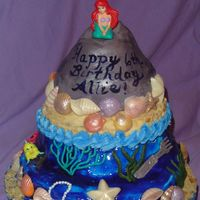 "Little Mermaid Birthday Cake  My first attempt at fondant. Covered two red velvet cupcakes and covered in fondant for top layer. Middle two layers are 8"" chocolate..."