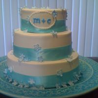 My Best Friends Wedding White buttercream, blue ribbon, and blue sugar flowers.