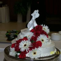 Wedding Cake This a wedding cake I made for my adopted daughters wedding. It is three tiers and it is made with red velvet and vanilla swirled. The...