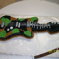 Camo Guitar This a grooms cake I did for our adopted daughter and her new hubby iit is a camo guitar. I did the pattern myself and the strings are made...