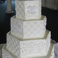Hex Shape Cake   Each side a mixture of buttercream work and sugar flowers. Lily of the valley topper is gumpaste.