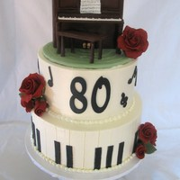 Piano Cake  Customer asked me to make an upright piano for her mother's 80th as that's been her passion her whole life. Cake iced in bc,...