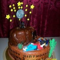 Cowboy Under The Stars everything is completely edible. made the cake look like leather by texturing the fondant. and the name on the side looks like it had been...
