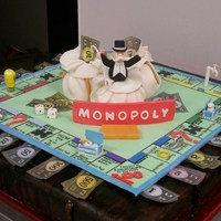 Monopoly Anyone???  EVERYTHING IS EDIBLE!!! This cake was as big as the actual game board. I made this getting my board out and sizing and measuring everything...