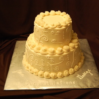 50Th Anniversary   2-9inch double rounds, topped by 2- 6 inch double rounds, fed 40. All buttercream.