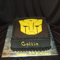 Transformers   10 inch double square, fed 40. Transformer done out of fondant.