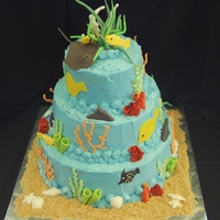 Coral Reef   2- 12 inch doubles, 2-9 inch doubles, topped by 2-6 inch doubles, fed 100. Royal icing orange coral, fondant accents.
