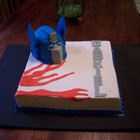 Transformer   rkt transformer head covered in fondant. french vanilla cake with raspberry filling and buttercream.