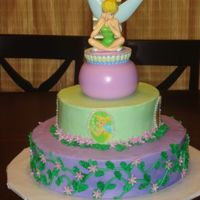 Tinkerbell   buttercream with fondant accents. I used my edible image printer for the first time with this cake and I love it.