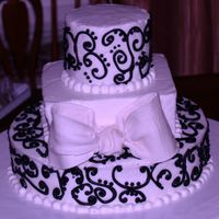 Pa111424.jpg  red velvet cake with cream cheese filling. Iced in buttercream. This was my first time using gumpaste and doing scrolls . I definitely see...