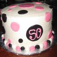 "Mod Momma Marble WASC with vanilla buttercream. 8""x4"" Fondant circles and buttercream icing."
