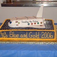 Blue And Gold Shuttle Cake Space Shuttle cake for my son's Cub Scout Pack Blue and Gold ceremony. 'Fins' made from fondant/gumpaste.