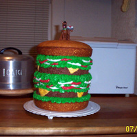 Scooby Doo Birthday Burger Giant Burger Cake with a Scooby Doo Candle topper.