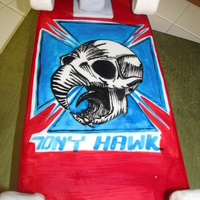 Tony Hawk Skate Board Cake chocolate cake with chocolate butter cream covered in mmf then painted with gel color mixed with vodka. wheels are rkt covered in mmf, and...