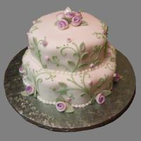 Karrie's Petal Cake   pearlized roses and leaves on rolled fondant has a delicate look on this petal shaped cake